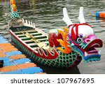 KAOHSIUNG, TAIWAN - JUNE 23: Traditional barges with dragon heads are being prepared for the 2012 Dragon Boat Races on the Love River on June 23, 2012 in Kaohsiung, Taiwan. - stock photo
