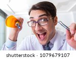 funny dentist with curing light ... | Shutterstock . vector #1079679107