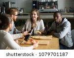 multiracial young friends... | Shutterstock . vector #1079701187