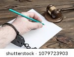 Hand In Handcuffs Writes A...