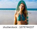 beautiful surfer girl on the... | Shutterstock . vector #1079744237