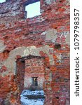 Small photo of ruins brick house ruined window door dips remained only the outer walls in the center of the wasteland snow
