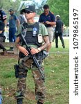 Small photo of CHARLOTTESVILLE, VA - August 12, 2017: Militia, white supremacists and counter-protesters during a white nationalist rally that turned violent resulting in one death and multiple injuries.
