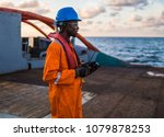 seaman ab or bosun on deck of... | Shutterstock . vector #1079878253
