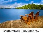 two adirondack chairs sitting... | Shutterstock . vector #1079884757