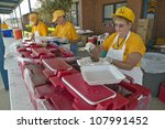 Relief workers from Red Cross offering food to weary after Hurricane Ivan hit Pensacola Florida - stock photo