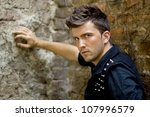 Fashion style photo of a handsome man. - stock photo