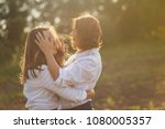 a woman with a daughter as a... | Shutterstock . vector #1080005357