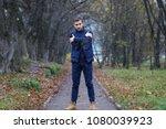 young beard man in a autumn park | Shutterstock . vector #1080039923