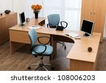 Monitors On A Desk At Modern...