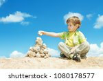 child putting last stone part... | Shutterstock . vector #1080178577