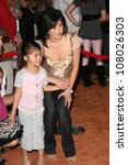 """Small photo of Kristi Yamaguchi and daughter Keara at the World Premiere of """"Wall E"""". Greek Theatre, Hollywood, CA. 06-21-08"""