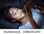 teen girl lying in bed at night ... | Shutterstock . vector #1080351293