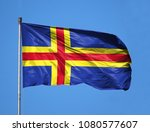 Small photo of National flag of Aland on a flagpole