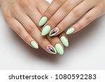 mint light green manicure on... | Shutterstock . vector #1080592283