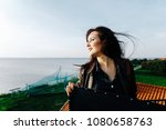 beautiful girl with her hair... | Shutterstock . vector #1080658763