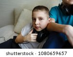 two brothers together listen to ... | Shutterstock . vector #1080659657