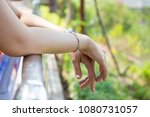 women resting at the balcony to ... | Shutterstock . vector #1080731057
