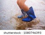 children wearing rain boots and ... | Shutterstock . vector #1080746393