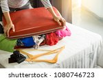 woman trying to fit all... | Shutterstock . vector #1080746723