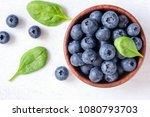 fresh blueberries in bowl on... | Shutterstock . vector #1080793703
