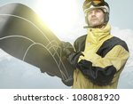 Snowboarder in the mountains - stock photo