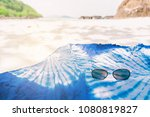blue scarf on the beach sand. | Shutterstock . vector #1080819827
