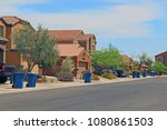 blue trash cans line the street ... | Shutterstock . vector #1080861503