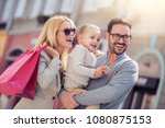 happy family with shopping bags ... | Shutterstock . vector #1080875153