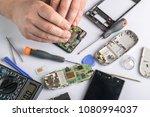 cell phone repair. smartphone... | Shutterstock . vector #1080994037