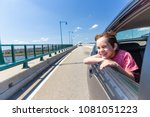 laughing boy looking out of car ... | Shutterstock . vector #1081051223
