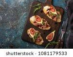 bruschetta with prosciutto ... | Shutterstock . vector #1081179533