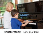 piano teacher giving lessons to ... | Shutterstock . vector #108119153