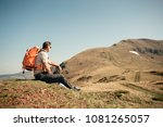 hiker taking a break  sitting... | Shutterstock . vector #1081265057