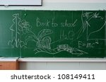Green chalk blackboard written Back To School with white chalk - stock photo