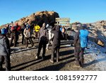Small photo of Kilimanjaro / Tanzania - 10.04.2015; Climbers and porters have a rest at Stella point on the trail to Uhuru peak, highest point of Kilimanjaro mount
