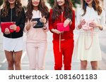 group of cheerful fashionable... | Shutterstock . vector #1081601183