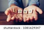 """the word """"love"""" in hands in...   Shutterstock . vector #1081629347"""