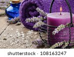 Spa setting in purple tone with lavender - stock photo