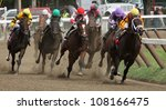 "SARATOGA SPRINGS - JUL 20: Jockey Rosie Napravnik and ""Kauai Katie"" lead the field around the far turn enroute to the filly's first win on Jul 20, 2012 in Saratoga Springs, NY. - stock photo"
