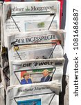Small photo of BERLIN - APR 28, 2018: Newspaper stand with various German newspapers and Angela Merkel and Donald Trump on the front cover of Die Welt newspaper.