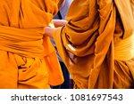 yellow robe of buddhist monks ... | Shutterstock . vector #1081697543
