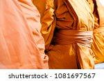 yellow robe of buddhist monks ... | Shutterstock . vector #1081697567