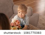cute little son giving flowers... | Shutterstock . vector #1081770383