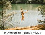 a young woman jumps off a cliff ... | Shutterstock . vector #1081774277
