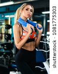 Small photo of Fitness woman sweating. Beautiful sport girl with towel and sweat looking at camera tired, exhausted and sweaty after gym exercise. Multiracial female fitness model isolated on blurred background.