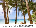 Small photo of BORACAY, PHILIPPINES - Jan 29, 2018: tourists sunbathe on the beach