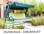 garden swing sofa in the summer ... | Shutterstock . vector #1081845197