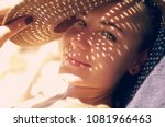 pretty woman on the beach ... | Shutterstock . vector #1081966463