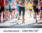 marathon runners in the city... | Shutterstock . vector #1081981787